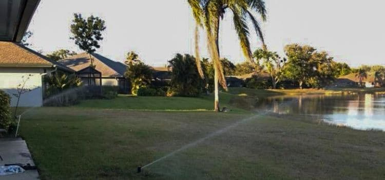A sprinkler system watering a lawn in Naples.