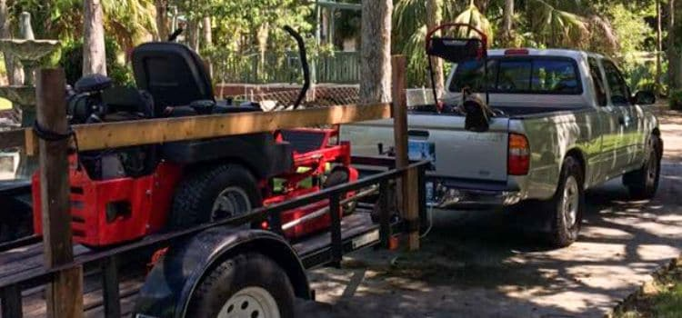 Equipment used by Leo Garden Care to service lawns on a trailer.